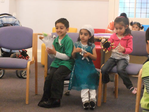 Children taking part in a story box workshop with a Family Learning Group
