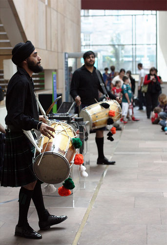 The drummers open the Tigerstyle performance with some Punjabi percussion. Photo © Jenni Sophia Fuchs.
