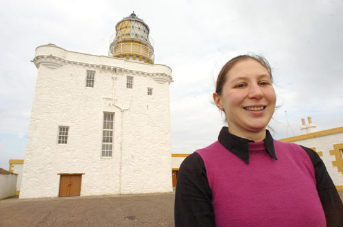 Virginia Mayes-Wright outside Kinnaird Head lighthouse, home of the Museum of Scottish Lighthouses