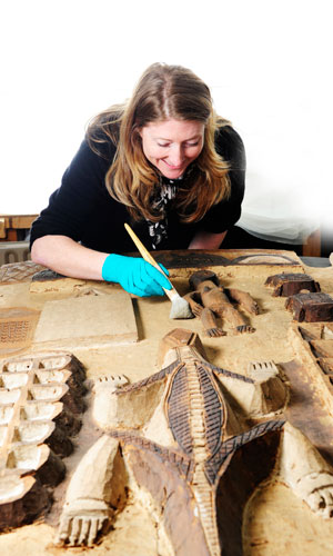 Conservation staff working at the National Museums Collection Centre