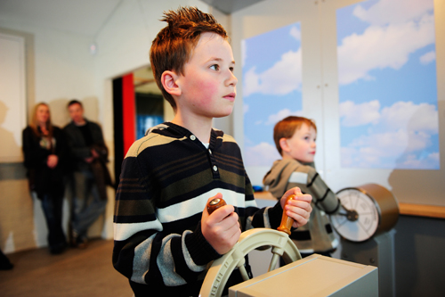 Boys piloting the R34 airship interactive in Fantastic Flight!