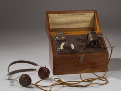 Crystal wireless receiver, type C form A made by the British Thomson-Houston Co. of Coventry, with variometer tuning, two switchable crystal detectors, a condenser, and in a polished wood box.