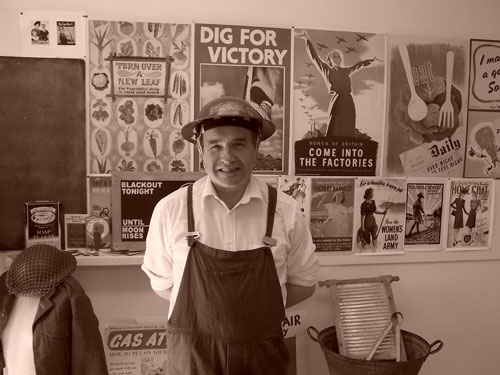 Our Air Raid Warden has his photo taken 1940s-style