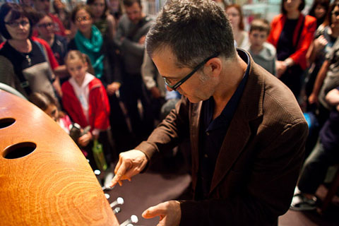 Victor Gama demonstrates one of his instruments at the opening of the National Museum of Scotland