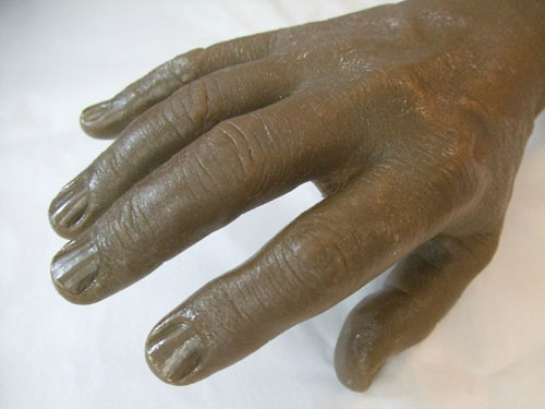 Resin cast of right hand used in the manufacturing of cosmetic gloves