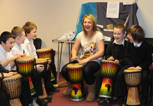 P6 practising the African drums at Methilhill Primary and Community School, Fife