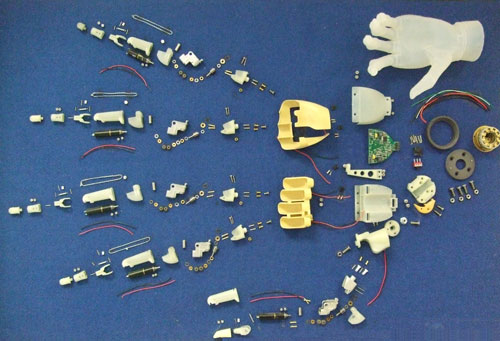 The about 300 parts which went into the first model i-limb, pinned to a noticeboard at Touch Bionics' workshop.