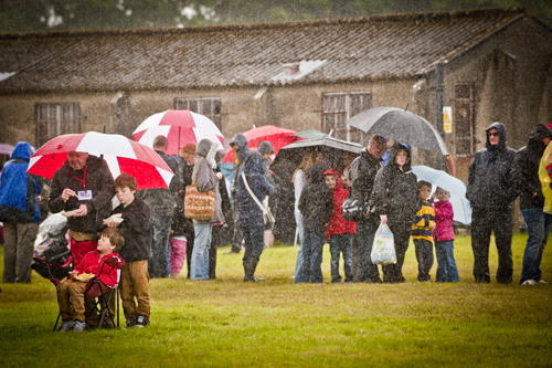 Crowd sheltering from the rain at the Airshow at National Museum of Flight, East Fortune on Sat 28 July 2012