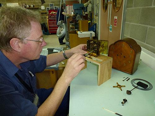 Working on a pendulum clock