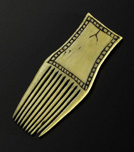 Woman's comb of walrus ivory, Inuit, collected by John Rae, likely 1848 or 1851.