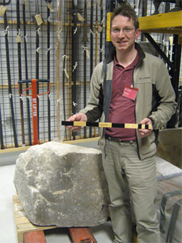 David Lightbody with the pyramid casing stone (A.1955.176) and his replica Egyptian cubit measuring rod