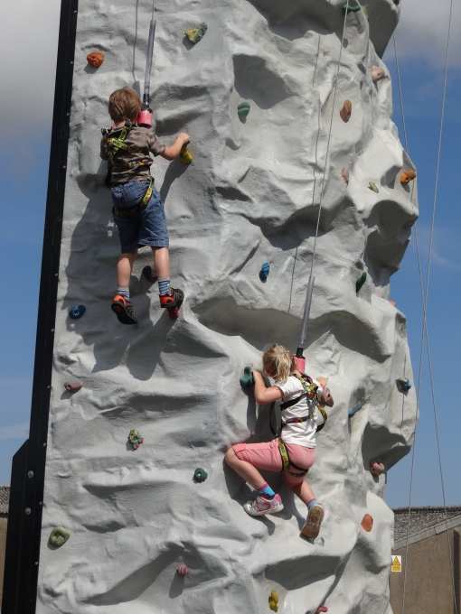 Visitors having a go at the climbing wall at the Airshow at the National Museum of Flight, East Fortune on Saturday 27 July 2013