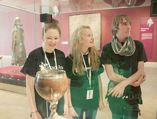 Participants with the coconut cup in the Discoveries gallery
